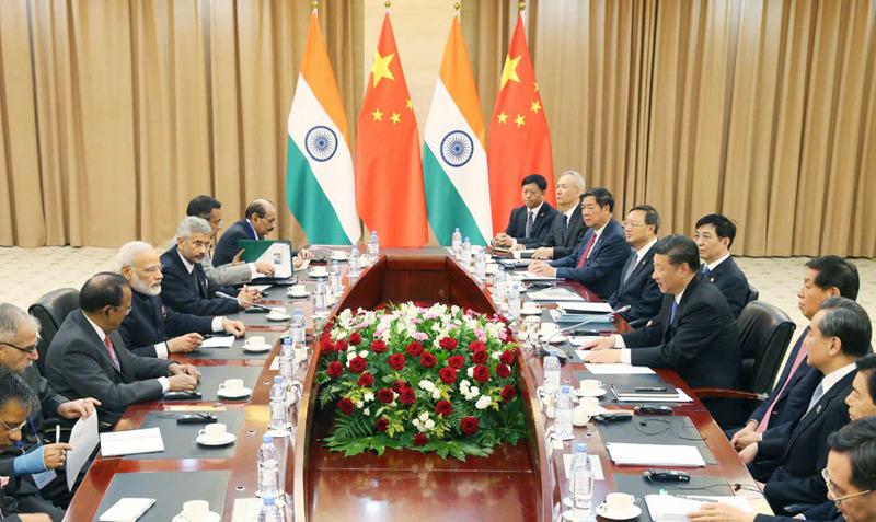 习近平会见印度总理莫迪。新华社记者姚大伟摄